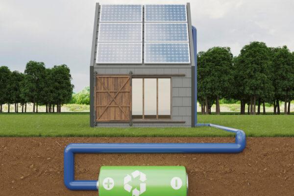 Magazyny energii na przykładzie grafiki domku, paneli słonecznych i baterii